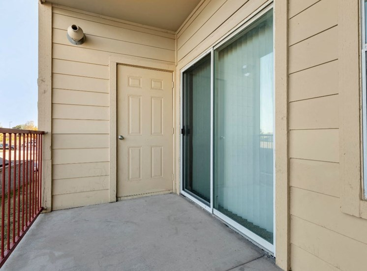 Balcony with storage door and sliding door