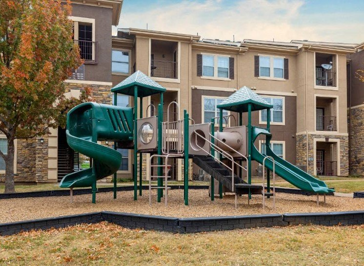 playground with building exterior in the background