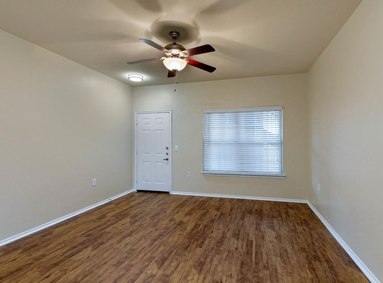 Living room with ceiling fan and hardwood style floors