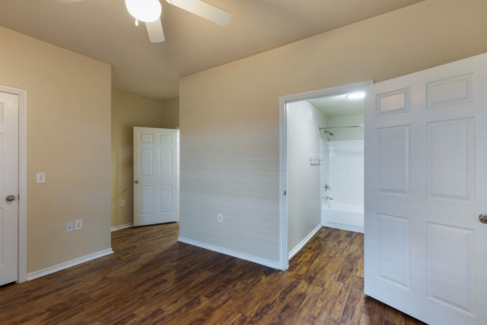 Living room with hallway and hardwood floors