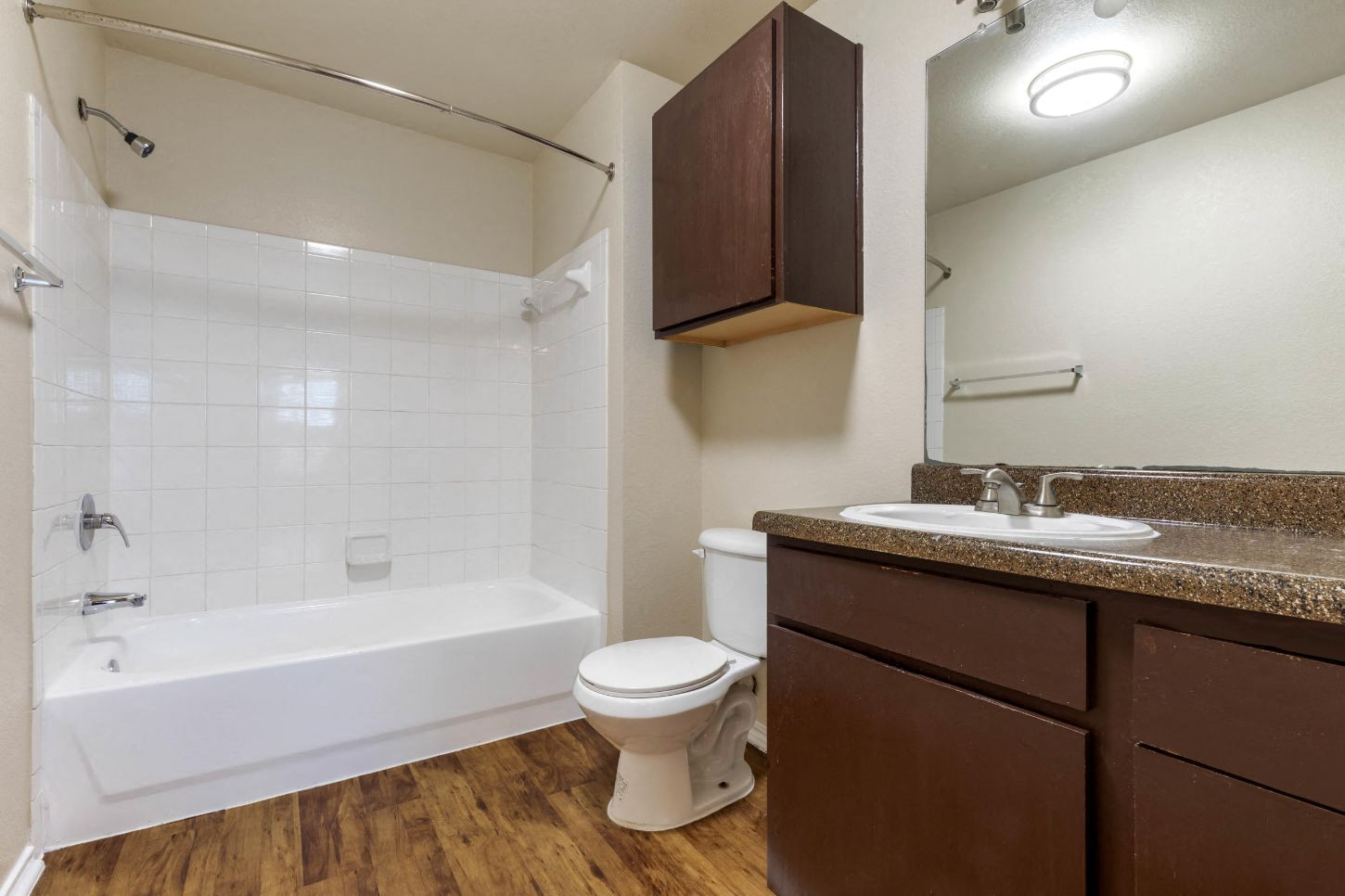 Bathroom with cabinet above storage