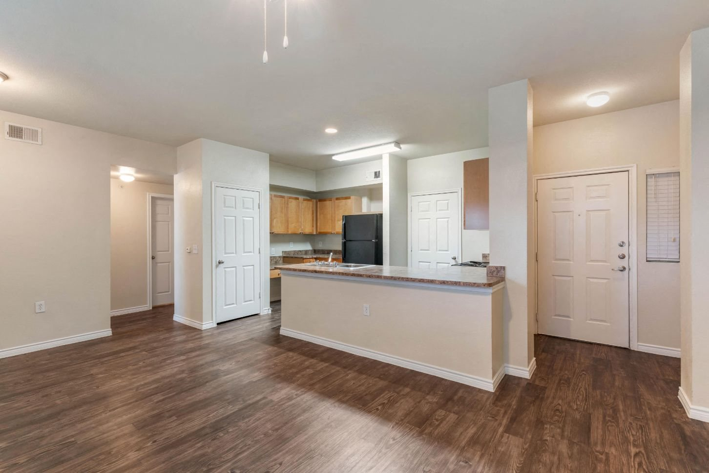 Providence at Marine Creek Apartment Homes | Kitchen with Hardwood Style Flooring