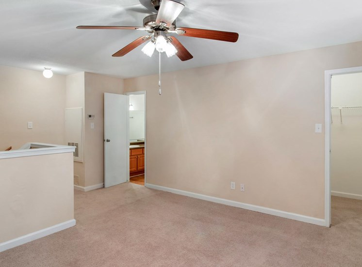 Living room with ceiling fan and wall to wall carpet