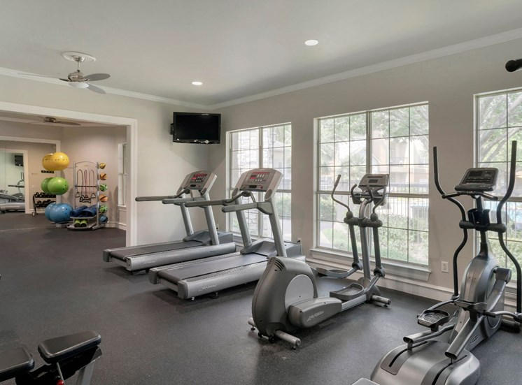 Fitness Center Cardio Equipment and Large Windows