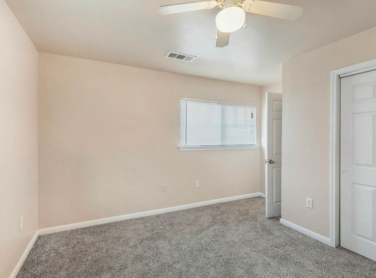 Bedroom with wall to wall carpet and ceiling fan