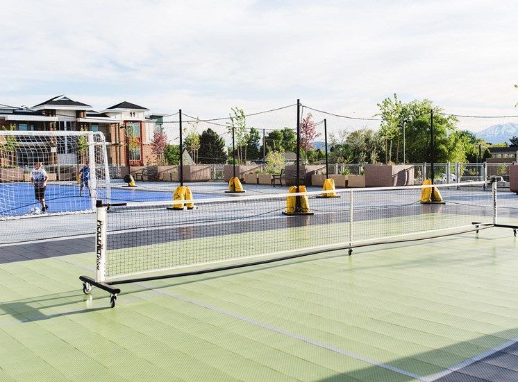 Green and Blue Sports Court with Soccer Goal Net and Tennis Net