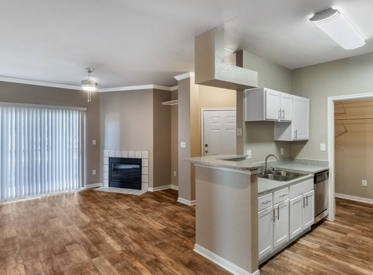 Kitchen with hardwood style flooring, brushed nickle appliances, and double basin sink