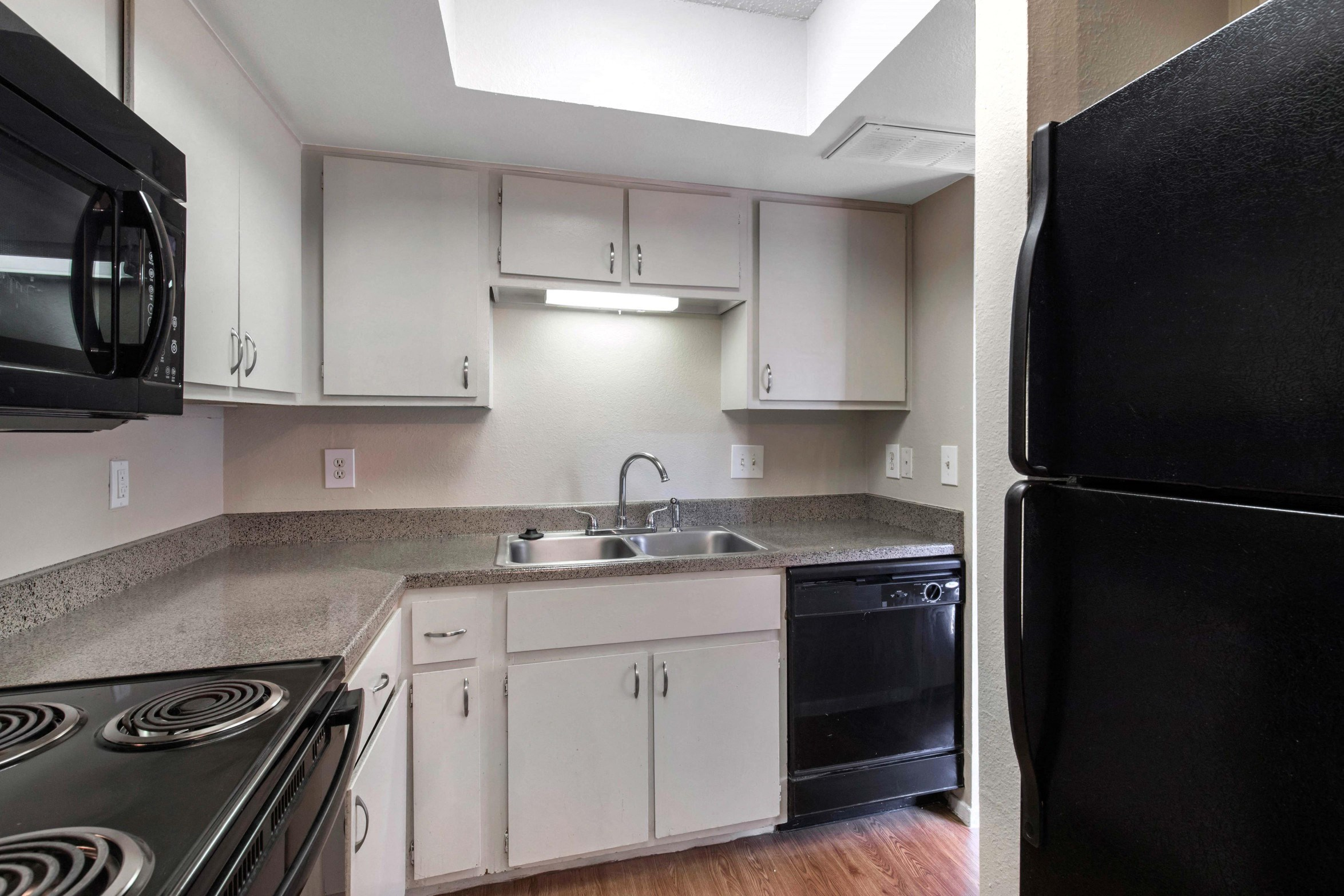 Briarcrest Kitchen with Black Appliances and double basin sink