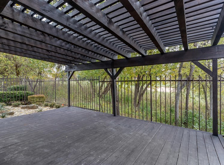 Spacious patio with pergola ceiling