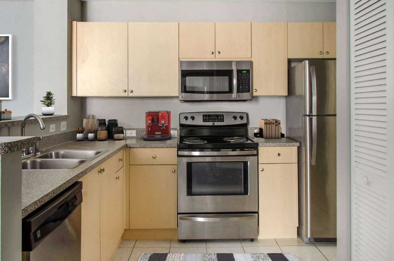 The Preserve at Deer Creek Apartments    Fully Equipped Kitchen with White Appliances and Tile Flooring