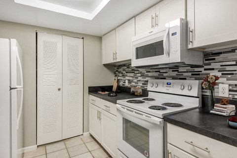 Fully Equipped The Cove at Boynton Beach Apartments   Kitchen with White Appliances