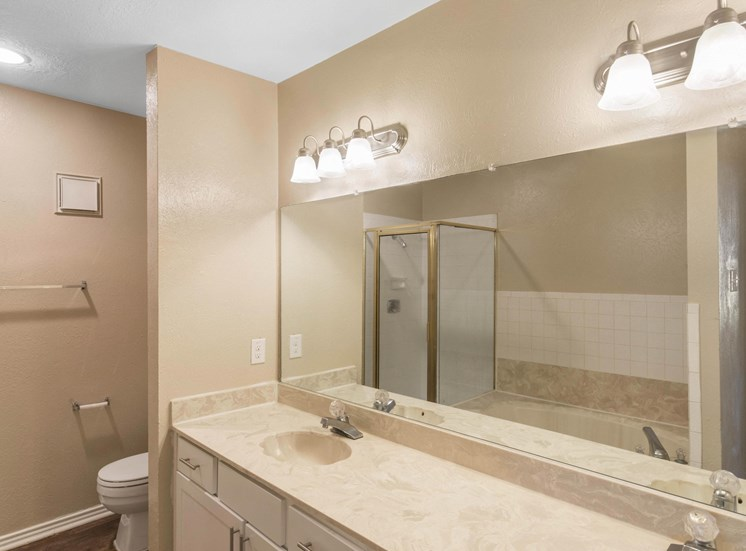 Bathroom with double vanities and large counter space with cabinets under the counter for storage