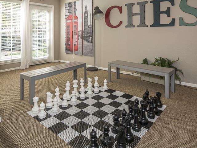 Billiards and game room with life-size chess set