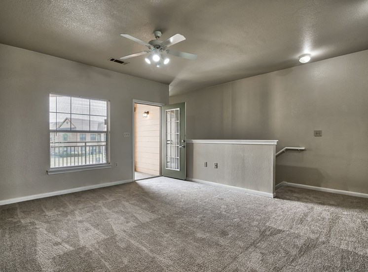 Living Room with Carpet Flooring and Private Patio Access