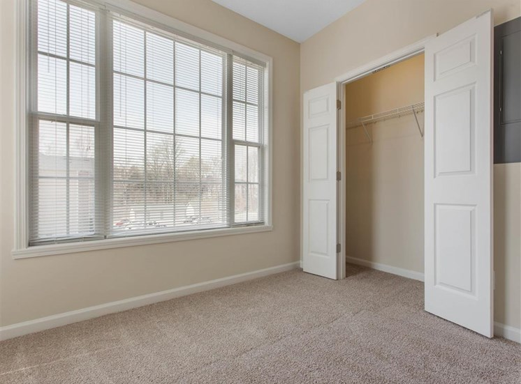 Carpeted Bedroom with En-Suite Bathroom and Closet