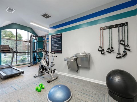 Bright Fitness Center with Large WIndows and Exercise Equipment and Water Fountains