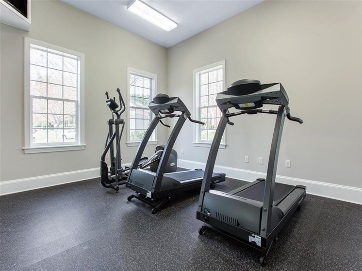 Fitness Center with Exercise Equipment Next to Windows