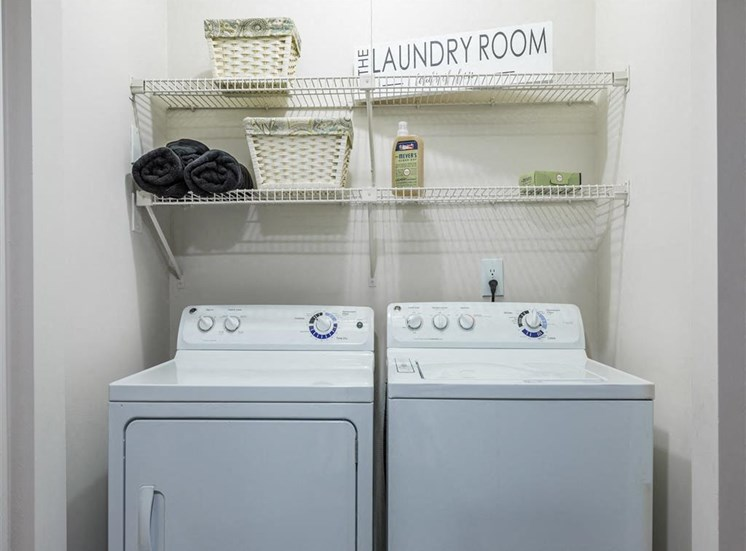 Utility Closet with Washer and Dryer Under Wire Shelves with Decorations