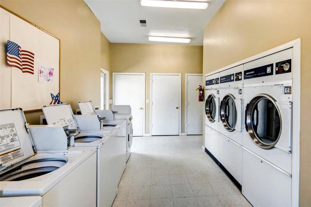 Laundry Facilities with Washers and Dryers and Bulletin Board on the Wall