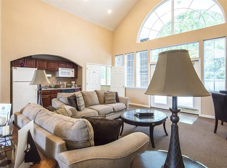 Clubhouse Seating Area with Kitchen with Wood Cabinets  Large Windows and Natural Light