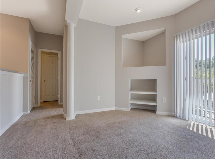 Living Room with Built in Entertainment Center Next to Sliding Glass Door