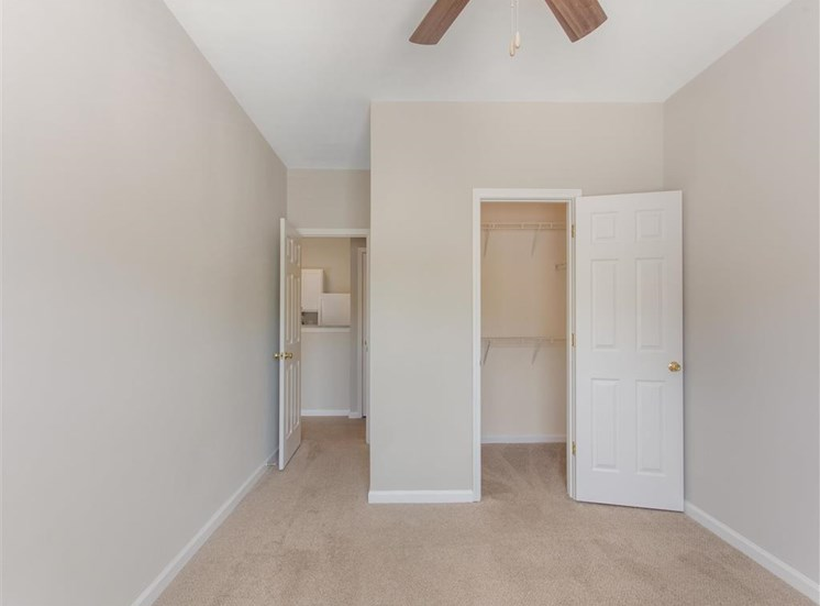 Carpeted Bedroom  with Walk in Closet