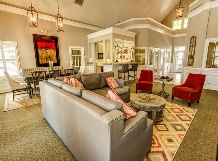 Clubhouse Seating Area with Grey Sectional Couch Red Chairs  with Dining Table