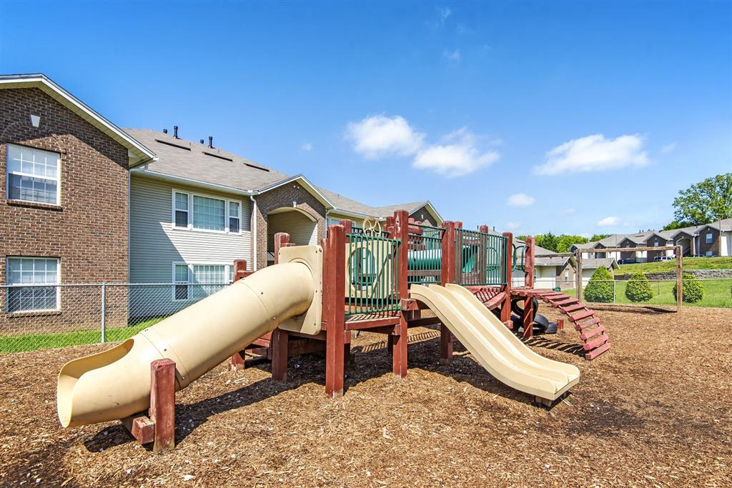 Wooden Playground with Yellow Slides and Green Railing