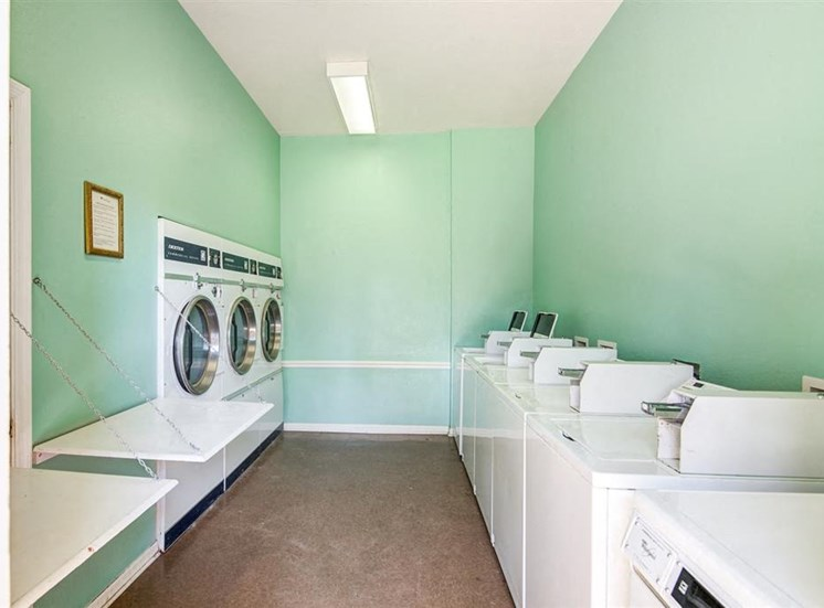 Laundry Facility with Washing Machines Dryers and Folding Shelves