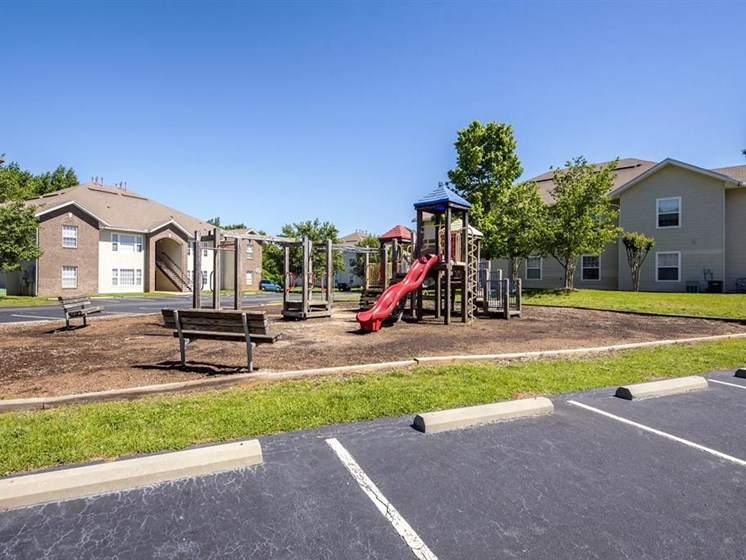 Parking Lot Wooden Playground with Colorful Accents and Building Exteriors  in the Background