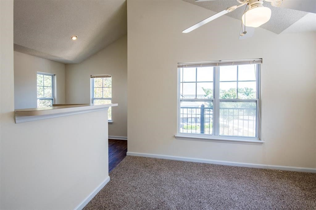 Overlooke at Simms Creek Apartments | 3rd Floor Living Room with Vaulted Ceilings