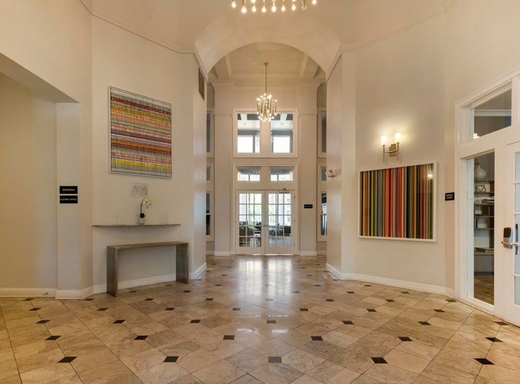 Large Open Leasing Office Foyer with French Doors and Art