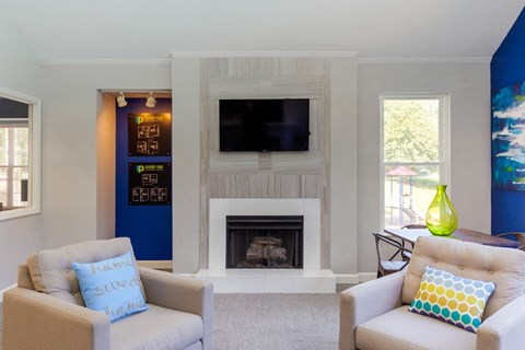 Clubhouse Seating Area Around Fireplace with TV Mounted Above it