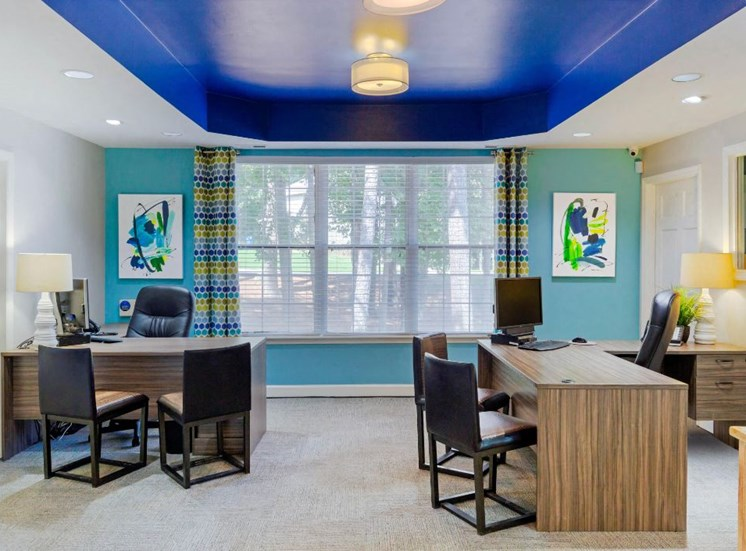Leasing Office Desks with Chairs and Light Blue Accent Wall