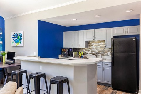 Clubhouse Kitchen Area with Breakfast Bar and Blue Accent Wall