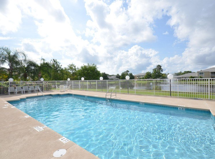 Swimming Pool And Relaxing Area at River Park Place Apartments, Florida