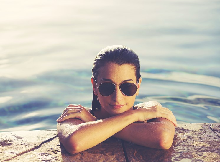 stock image of woman in pool