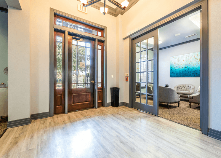 Leasing office interior entrance with wood style flooring