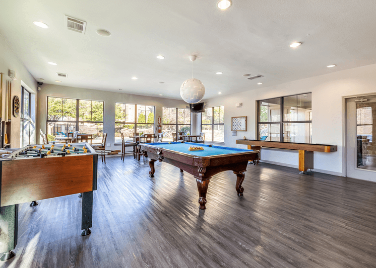 Game room with wood style flooring and billiard tables