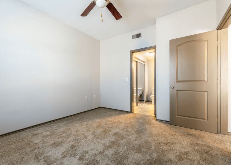 Carpeting bedroom with ceiling fan