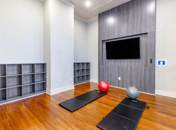 Fitness Center with Yoga Mats and Mounted TV