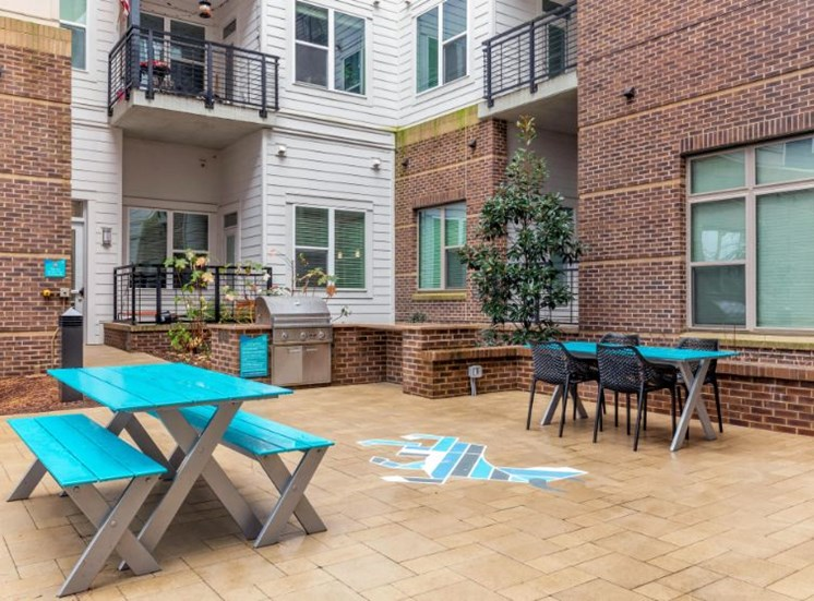 Outdoor Lounge with Summer Kitchen with Grill and Blue Tables