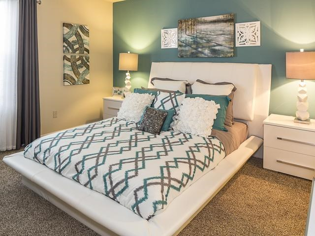 Model Bedroom with White Platform Bed and Headboard with Nightstands