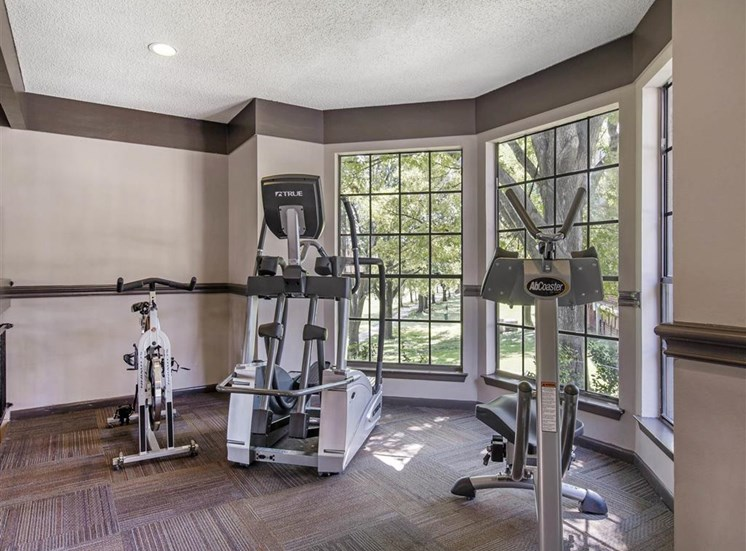 Fitness Center with Exercise Equipment  and Large Windows