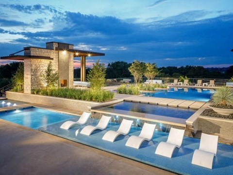 Resort Style Swimming Pool with Lounge Seating