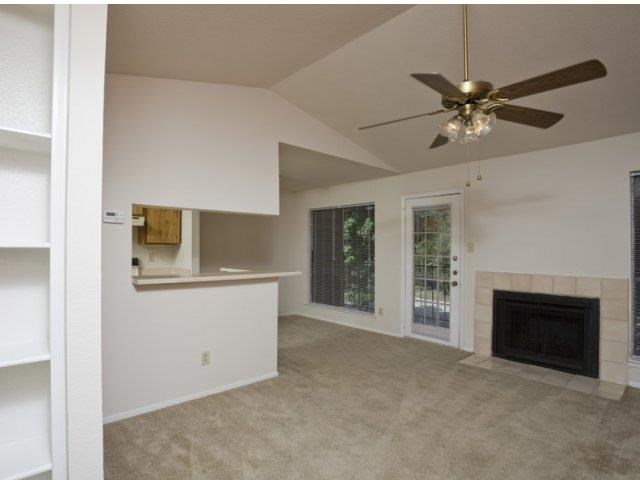 Living Room with Custom Built-ins and Fireplace with Tile Surround