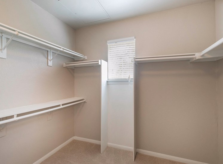Walk in closet with built in shelf