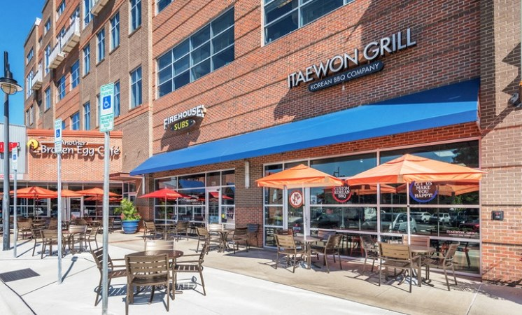 Community exterior with local restaurants with patios and umbrellas