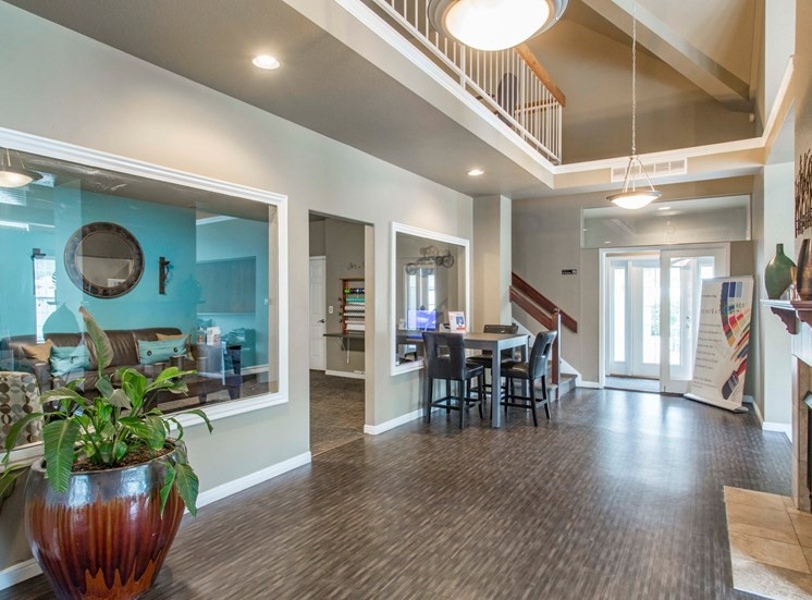 Clubhouse Foyer with hardwood style flooring, decorations and chairs