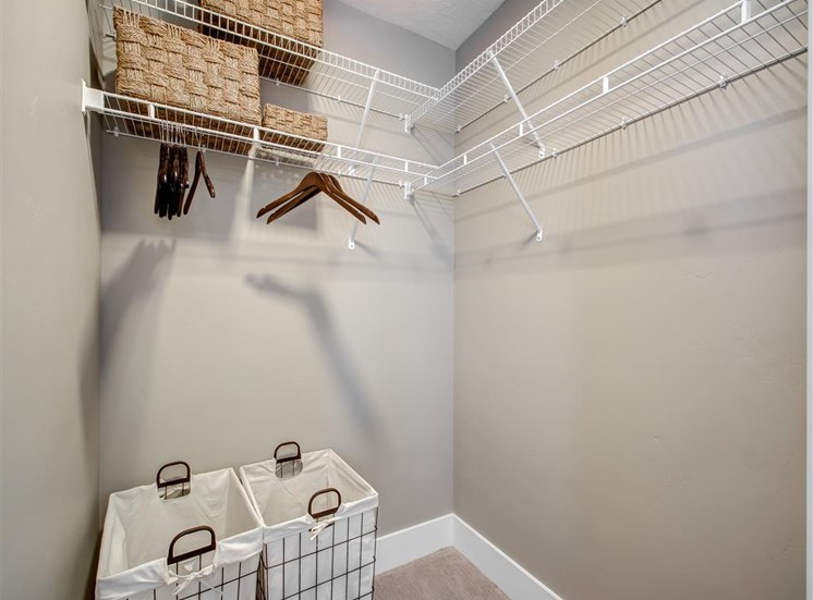 Walk in Closet with WIre Shelves and Decorative Boxes